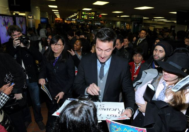"""Richard at Union Station in Toronto, checking out one of those """"rubbish""""signs fans make to get his attention."""