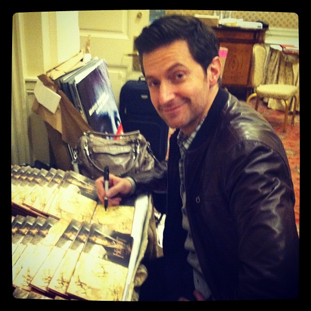 Richard signing autographs in NY. Courtesy of RANet. Wonder if that beautiful hand got cramps? Is it just me, or is he channeling a bit of Harry Kennedy here?