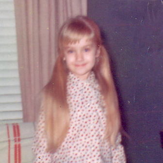 Yours truly at the tender age of five, I believe. Not the longest my hair has ever been, either.