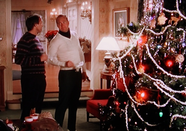 Clark (Chevy Chase) and Cousin Eddie (Randy Quaid) before the ginormous Christmas tree.