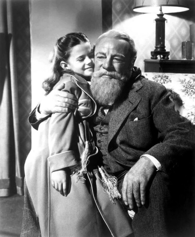 "Suzie (Natalie Wood) and Chris (Edmund Gwenn) in a scene from ""Miracle on 34th Street."""