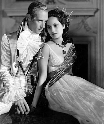 Leslie Howard and Merle Oberon as Sir Percy and Marguerite in the 1934 Hollywood version of TSP, considered the definitive adaptation by some fans.
