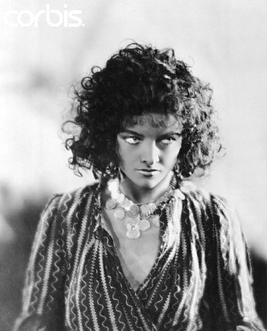 "Myrna Loy as the seductive, conniving gypsy Nubi in ""The Squall."" Image Bettman/CORBIS"
