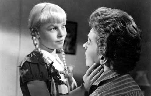 "Patty McCormick and Nancy Kelly as the evil little pig-tailed Rhoda and her mother in the 1956 film ""The Bad Seed."""