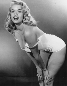 "Jane Mansfield, who poked fun at her voluptuous blonde image in ""The Girl Can't Help It."""