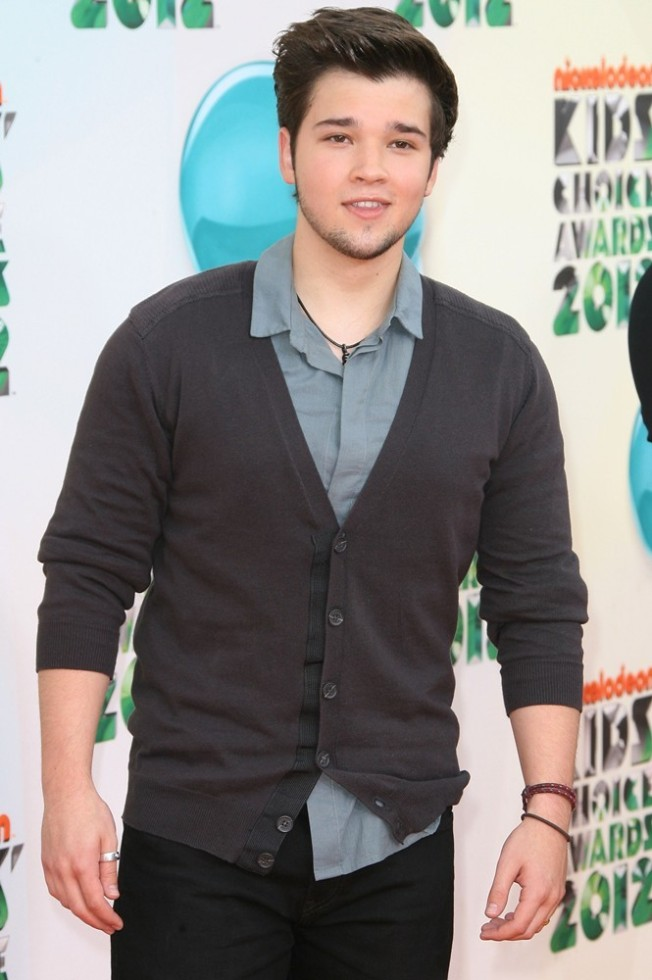 Nathan at last year's Kid'sChoice Awards. Re the cardi, like father, like son?