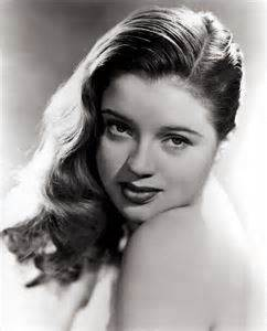 A rather sweet and demure-looking young brunette Diana Dors.
